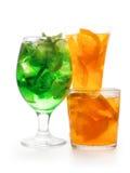 Tre nya citrusa coctailar i olika exponeringsglas Llime och ora Royaltyfri Fotografi