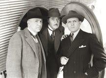 Tre nyfikna män Royaltyfri Foto