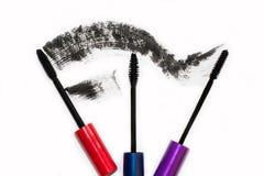 Tre olika borstar av svart mascara för ögonfrans Royaltyfri Foto