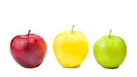 Tre olika färgrika äpplen Royaltyfria Foton