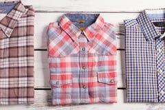 Tre olika kontrollerade skjortor Arkivbild