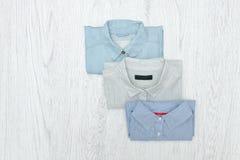 Tre olika skjortor trendigt begrepp sortiment Fotografering för Bildbyråer