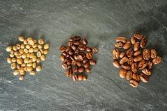 Tre olika sorter av kaffe Arkivfoton