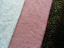 Tre olika texturer av tyg arkivfoto