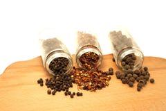 Tre olika typer av peppar Royaltyfri Bild