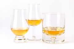 Tre olika whiskyexponeringsglas Royaltyfri Fotografi