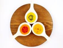 Tre oljor med kryddor i bunkar Royaltyfri Bild