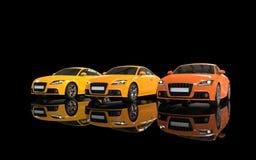 Tre orange bilar Fotografering för Bildbyråer