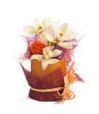 Tre orchidee con la palla arancio in un vaso di plastica   fotografia stock