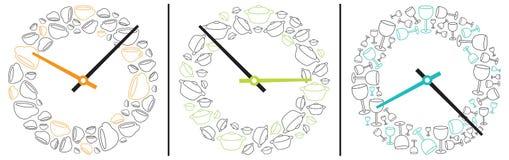 Tre orologi che mostrano tempo mangiante e bevente Fotografia Stock Libera da Diritti
