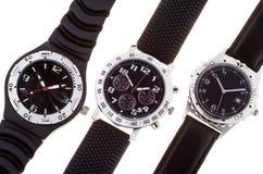 Tre orologi con parecchi quadranti Fotografie Stock