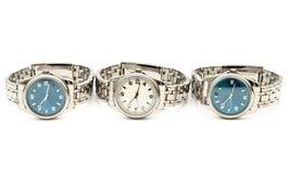 Tre orologi inossidabili del `s degli uomini Immagini Stock