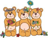 Tre orsacchiotti della ragazza con i fiori Fotografia Stock Libera da Diritti