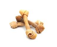 Tre ossa di cane Fotografia Stock