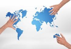 Tre pålagda olika delar för manliga händer av världskartan arkivbilder