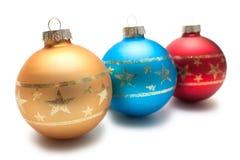 Tre palle di Natale in una fila Fotografia Stock