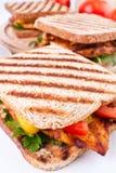 Tre panini di pollo cotti Fotografia Stock Libera da Diritti
