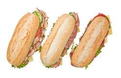 Tre panini di sottomarino su priorità bassa bianca Immagine Stock