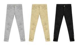 Tre pantaloni del jacquard in argento, in oro e nel nero, isolati su briciolo Immagine Stock