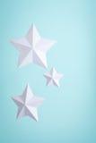 Tre pappers- stjärnor arkivfoton