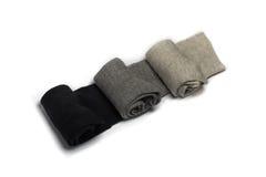 Tre par av sockor som isoleras på en vit bakgrund Arkivbilder