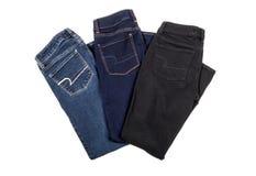 Tre par jeans Fotografering för Bildbyråer