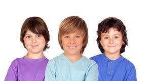 Tre partnerpojkar royaltyfria foton