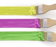 Tre pennelli con differenti colpi della pittura Fotografia Stock Libera da Diritti