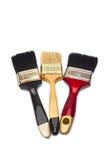 Tre pennelli dei colori differenti Fotografie Stock Libere da Diritti