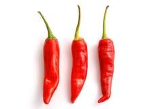 Tre peperoni di peperoncini rossi Fotografia Stock