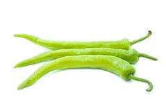 Tre peperoni di peperoncino rosso giallo verde Immagini Stock