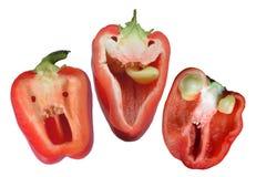 Tre peperoni divertenti rossi pronti per Halloween Fotografie Stock