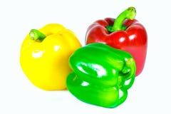 Tre peperoni dolci isolati su fondo bianco Fotografia Stock