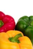 Tre peperoni dolci - rossi, gialli e verdi Fotografia Stock Libera da Diritti
