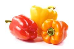 Tre peperoni dolci su bianco Fotografia Stock