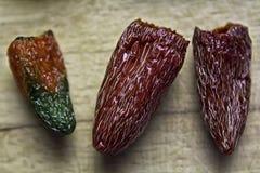 Tre peperoni secchi Fotografia Stock Libera da Diritti