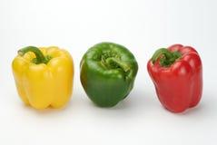 Tre peppar, rött som är gröna, guling Arkivbild