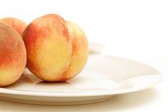 Tre persikor Arkivbild