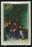 Tre personer som sitter nära vagga av Dura Jaksic Arkivbilder