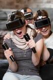 Tre personer som spelar en lek Royaltyfria Foton