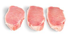 Tre pezzi di carne di maiale cruda Fotografie Stock Libere da Diritti