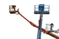 Tre piattaforme aeree idrauliche sostitute per lavoro ad alta altitudine isolato fotografia stock libera da diritti