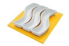 Tre piatti bianchi Fotografia Stock
