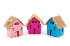 Tre piccole case di colore Immagine Stock