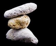 Tre pietre pomici sul nero Immagine Stock