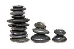 Tre pile di pietre Fotografia Stock