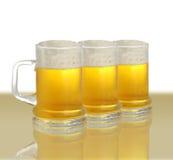 Tre pinte di birra Immagine Stock