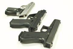 Tre pistole Fotografia Stock