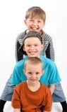 Tre pojkar Royaltyfri Bild