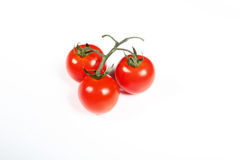 Tre pomodori ciliegia su bianco Fotografie Stock Libere da Diritti